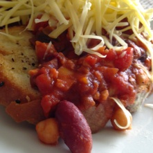 Home-made chilli on a crouton with Violife cheese